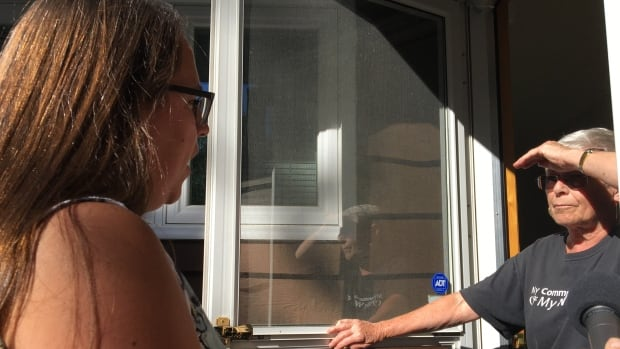 Ward 5 candidate MIranda Jimmy speaks to Laurier Heights resident Elva Jones during while canvassing her street.