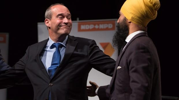 Guy Caron, left, and Jagmeet Singh come together on stage after the final federal NDP leadership debate in Vancouver Sept. 10. Caron will be the NDP's leader in the Commons since Singh doesn't hold a federal seat.