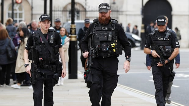 U.K. police conduct armed search of London suburb after ...