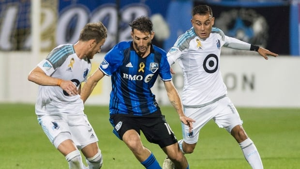 Ignacio Piatti, centre, of the Impact is challenged by Jerome Thiesson, left, and Johan Venegas of Minnesota United during Montreal's 3-2 loss on Saturday.