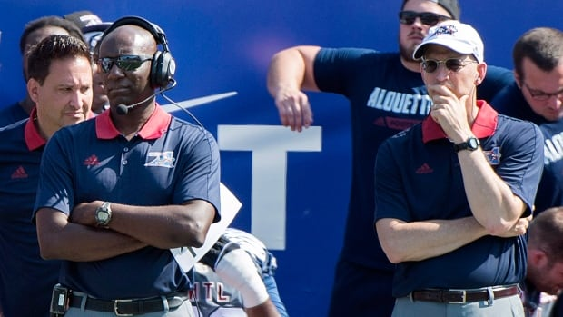 Montreal Alouettes head coach and general manager Kavis Reed, left, looks on from the bench during the first half against the Ottawa Redblacks in Montreal on Sunday.