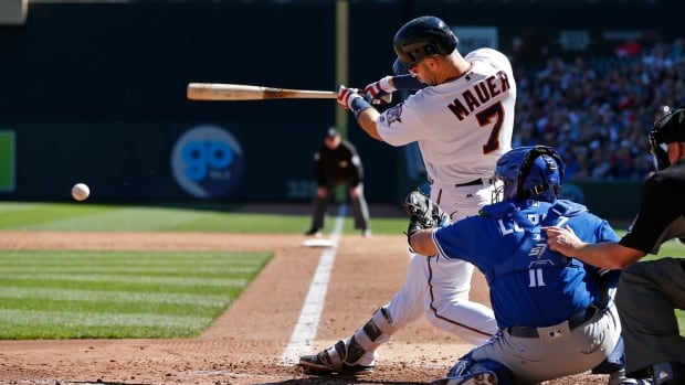 Joe Mauer drives in two runs as part of an explosive second inning for the Minnesota Twins who defeated the Toronto Blue Jays 13-7 on Sunday.
