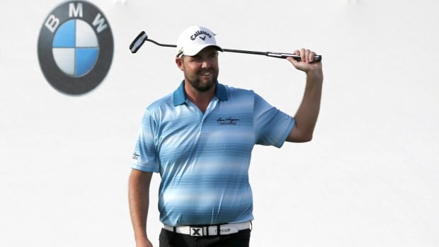 Marc Leishman celebrates after winning the BMW Championship golf tournament at Conway Farms Golf Club.