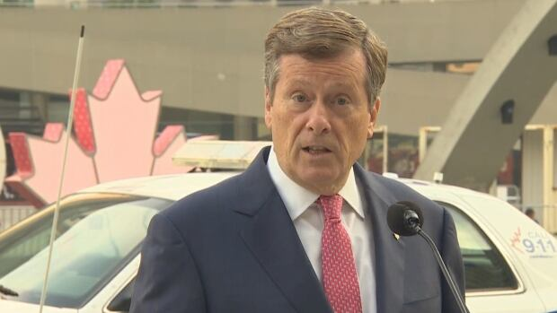 """Mayor John Tory says the city plans to deploy full-time """"traffic wardens"""" at major intersections to manage the flow of vehicles and pedestrians starting early next year."""