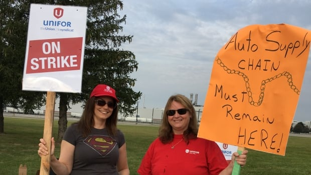 Lori Perkins, left and Bonnie Murphy work for Autrans, a company that supplies engines for the Cami plant in Ingersoll. They say the local economy relies heavily on the GM plant, which employs 2,800 people