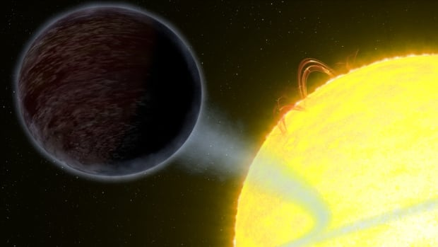 An artist's impression shows the exoplanet WASP-12b — an alien world as black as fresh asphalt, closely orbiting a star like our sun.