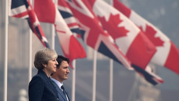 British Prime Minister Theresa May stands with Prime Minister Justin Trudeau during a welcoming ceremony in Ottawa on Monday.
