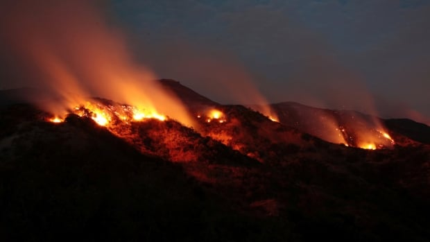 Among this year's extreme weather events were wildfires that scorched Europe and North America, including the La Tuna Canyon fire over Burbank, Calif., seen on Sept. 2, 2017.