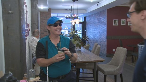 Susan Vaile enjoys her order at 9 Bars Coffee in Toronto. An app on her phone communicated with a beacon in the coffee shop to give her directions to the counter.