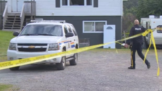 Police taped off a basement apartment on McGettigan Boulevard in Marystown, where the body of a woman, 18, was discovered Saturday.