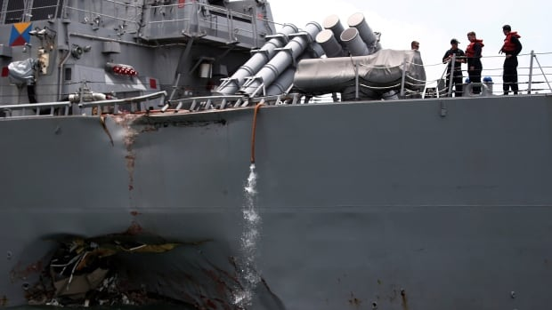 The U.S. navy guided-missile destroyer USS John S. McCain is seen after a collision, in Singapore waters on Aug. 21. Ten soldiers died in the collision.