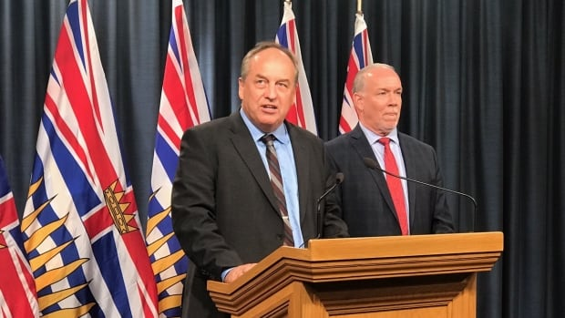 """B.C. Green Party Leader Andrew Weaver and B.C. Premier John Horgan address the media after announcing legislation to ban """"big money"""" from provincial politics on Monday."""