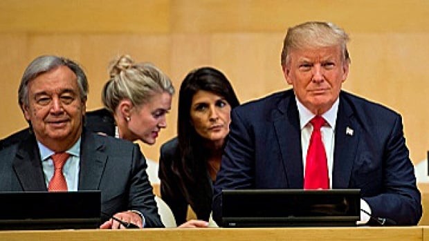 U.S. President Donald Trump, centre, waits for a meeting on United Nations Reform at the UN headquarters on Monday in New York. UN Secretary General Antonio Guterres, left, U.S. Ambassador to the UN Nikki Haley, rear right, and Thailand's Foreign Minister Don Pramudwinai are also pictured.