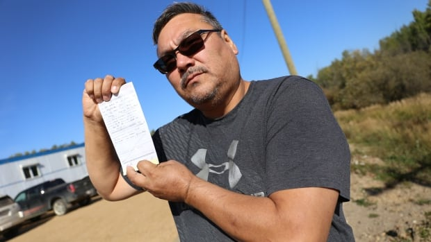 Métis leader Ernie Desjarlais with his ticket for fishing without a licence.