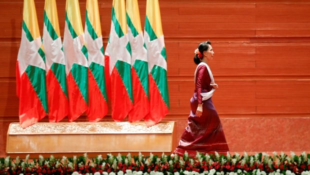 Myanmar leader Aung San Suu Kyi walks off the stage after delivering a speech in the capital, Naypyitaw, that defended her country against international criticism over the treatment of Rohingya Muslims.