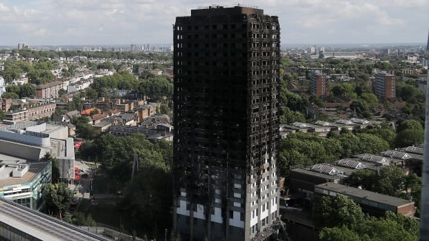 The scorched facade of the Grenfell Tower in London after a massive fire raced through the 24-storey highrise apartment building in west London. British police said Tuesday that manslaughter charges may follow in the coming months.