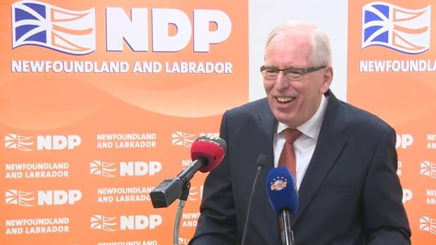 Earle McCurdy jokes with reporters after a news conference Tuesday to announce he is stepping down as NDP leader.