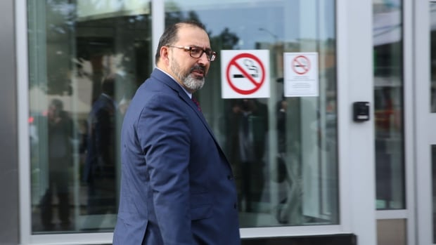 Sudbury MPP Glenn Thibeault walks to court Tuesday morning to testify at the trial of two Liberals charged with bribery ahead of the 2015 byelection.