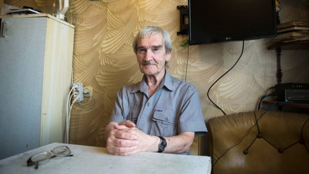 Former Soviet missile defence forces officer Stanislav Petrov poses for a photo at his home in Fryazino, near Moscow, on Aug. 27, 2015.