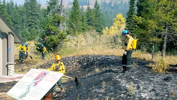 Wildland firefighters work to protect visitor facilities at Red Rock Canyon in Waterton Lakes National Park.