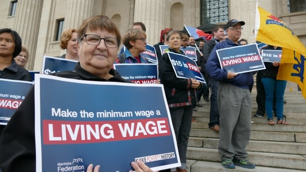 Dozens met on the steps of the Manitoba Legislature to rally for an increase to the province's minimum wage on Tuesday.