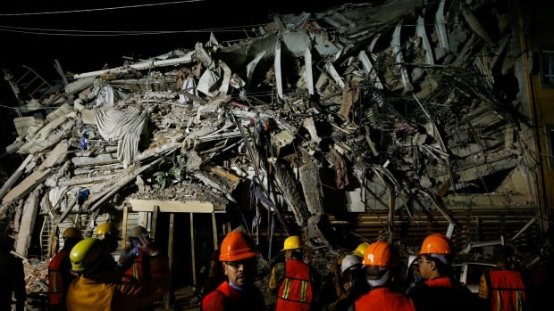 Rescuers work at the site of a collapsed building after an earthquake in Mexico City, Mexico September 20, 2017.