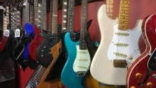 guitars on rack at Most Wanted Jewelry & Pawn