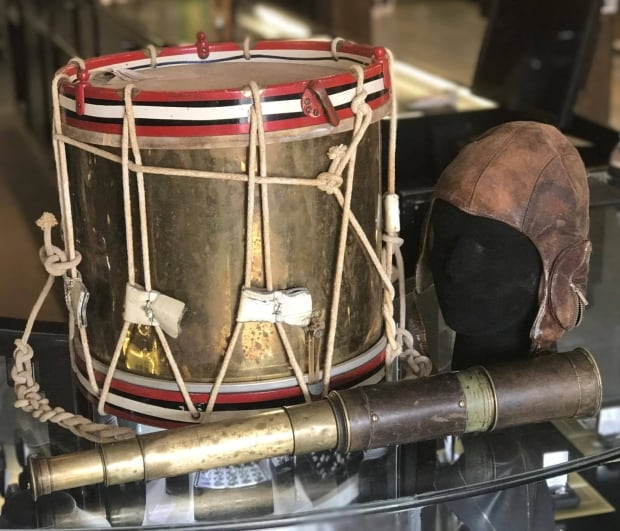 antique drum, leather football helmet and spy glass