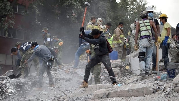 Rescuers, firefighters, policemen, soldiers and volunteers search for survivors in Mexico City on Wednesday. A powerful 7.1 earthquake shook Mexico City on Tuesday, causing panic among the city's 20 million inhabitants on the 32nd anniversary of a devastating 1985 quake.