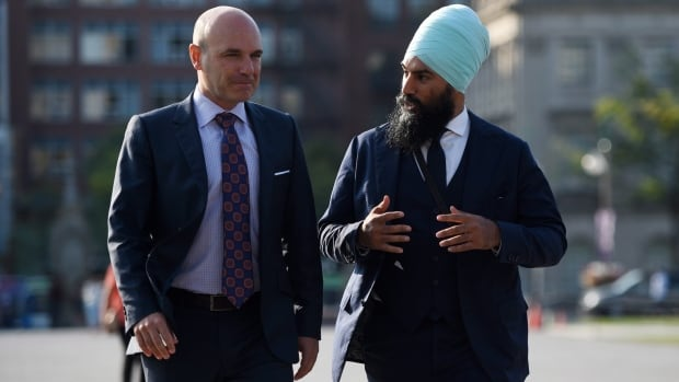 NDP leadership candidate Jagmeet Singh walks with NDP MP Nathan Cullen on Parliament Hill in Ottawa on Wednesday, Sept. 20, 2017. The Veteran New Democrat MP is throwing his weight behind the leadership bid of upstart candidate Singh, a member of the Ontario legislature.