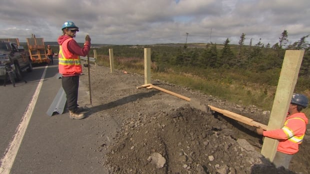 The existing guardrail near the Foxtrap Access Road is being extended by workers who were at the site on Wednesday.