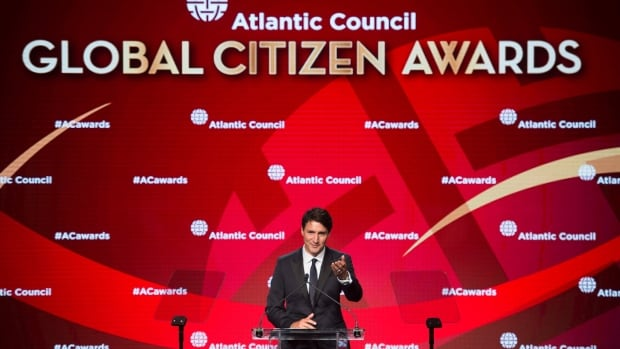 Canadian Prime Minister Justin Trudeau gestures to his wife Sophie as he speaks at the Atlantic Council Global Citizen Awards Gala dinner at the Intrepid Sea, Air & Space Museum in New York City Tuesday.
