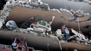 Mexico quake rescuers search school rubble, 52 people saved from collapsed buildings in capital