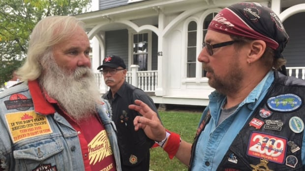 Art Brown (left) and Randy Thurber, Defenders motorcycle club members