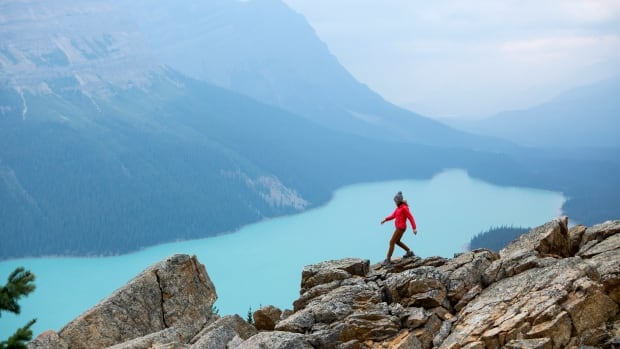 A woman hiking above a vibrant turquoise lake in Banff National Park is the bestselling stock photo of 2017, according to Getty Images, revealing a remarkable transformation in the media representation of women over the past decade.