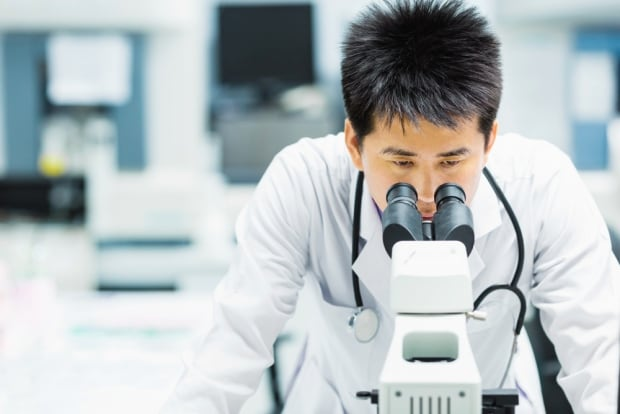 Scientist microscope lab science