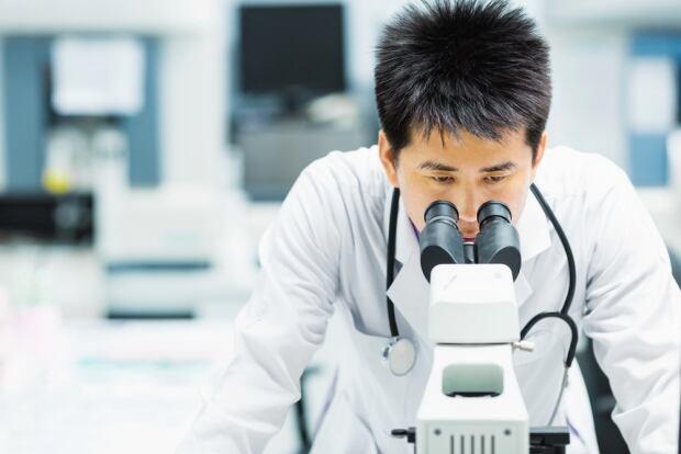 Scientist microscope lab science