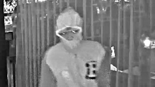 Toronto police have released security footage and images of the gunman wanted in the fatal shooting of Simon Giannini at Michael's on Simcoe restaurant on Sept. 16.
