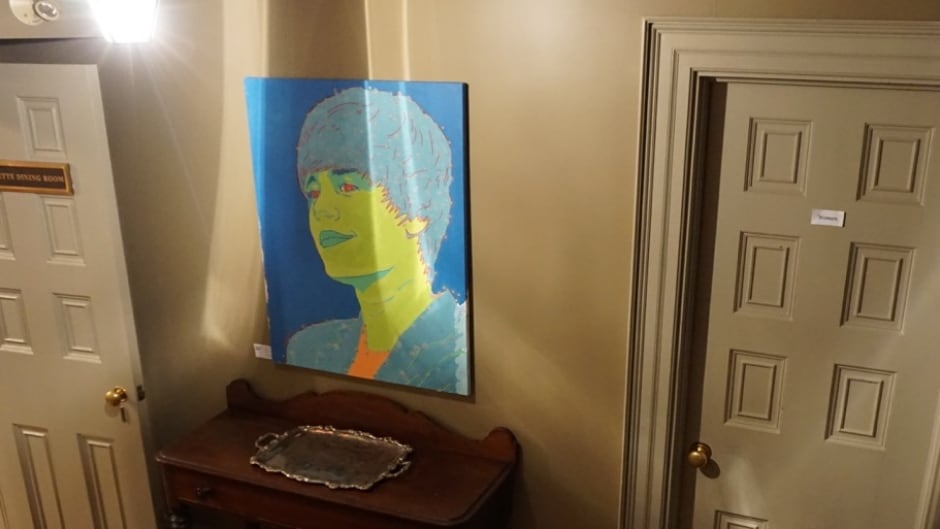 This painting, appraised at $18,000, was stolen during a TIFF event.