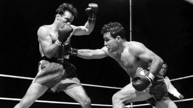 Jake LaMotta, right, fights Marcel Cerdan in Briggs Stadium in Detroit in June 1949. LaMotta knocked out Cerdan in the 10th round to become the new world middleweight champion. LaMotta died Tuesday at 95.