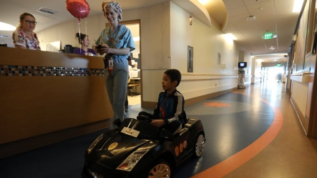 Dr. Daniela Carvalho controls Jonathan Jauregui, 7, remotely as the Rady Children's Hospital in San Diego unveils a program that uses remote-control cars to take young patients to the operating room.