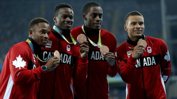 From left to right, Akeem Haynes, Aaron Brown, Brendon Rodney and Andre de Grasse will spend part of the next few weeks hosting a series of six-minute walks across Canada to raise awareness for idiopathic pulmonary fibrosis (IPF), a rare and fatal lung condition.