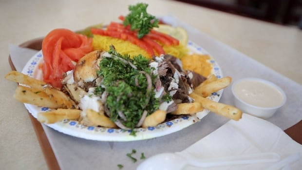 Food writer Suresh Doss says the mixed shawarma plate at Ghadir Meat & Restaurant is a must-have and encourages you to get the 'whole shebang.'