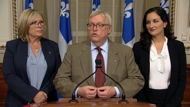 Quebec Health Minister Gaétan Barrette, accompanied by Francine Charbonneau, Quebec's Minister responsible for Seniors, left, and his parliamentary secretary, MNA Marie Montpetit, said the funds will go toward hiring additional employees or paying overtime to existing staff to provide an extra bath and shower to CHSLD residents.