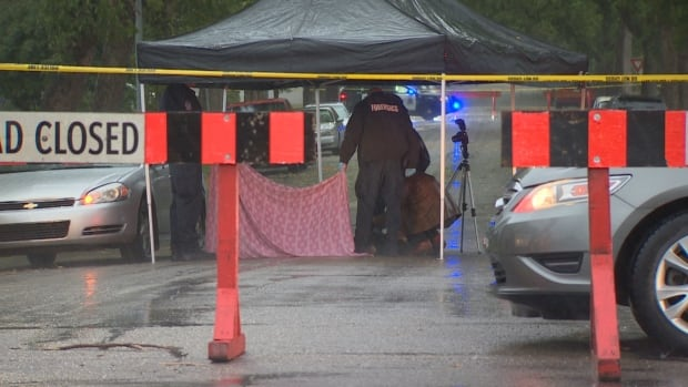Police at a crime scene in northeast Edmonton on Tuesday, where a man was found dead in a car; his death has since been ruled a homicide.