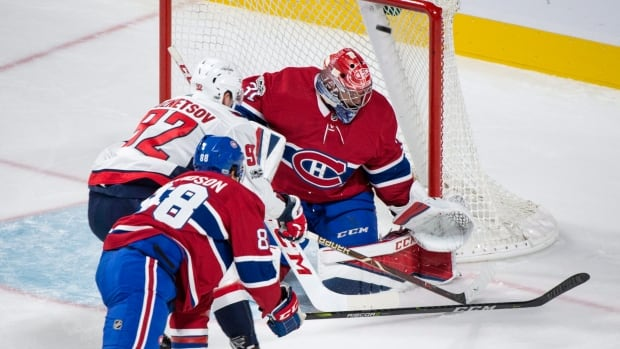 Washington Capitals' Evgeny Kuznetsov scores past Montreal Canadiens goalie Carey Price as he is followed by defenceman Brandon Davidson.