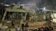 Mexico earthquake leaves rescuers digging for survivors in flattened elementary school