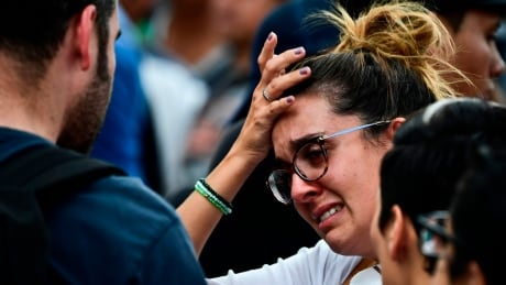 Mexico quake rescuers race to free girl, other survivors thumbnail