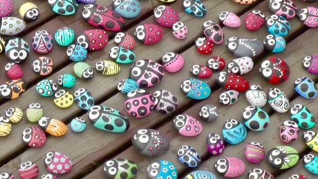 ladybug rocks on the deck