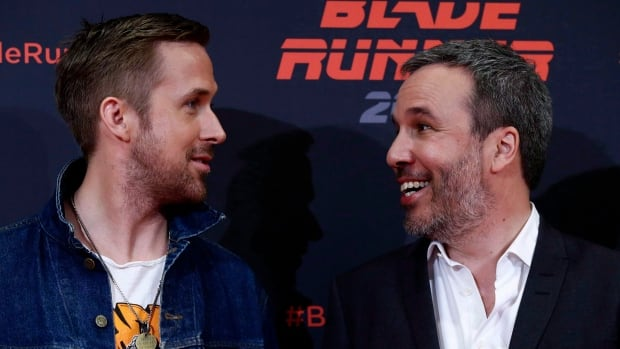 Actor Ryan Gosling, left, and Director Denis Villeneuve pose for the media during a photo call to promote Blade Runner 2049.